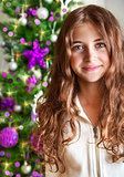 Sweet girl portrait near Christmas tree