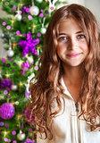 Sweet girl portrait near Christmas tree