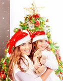 Mother with daughter celebrate Christmas
