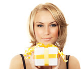Beautiful female holding gift box