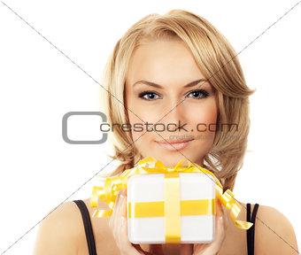 Beautiful female holding gift box