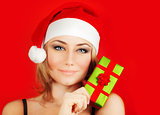 Happy Santa girl holding Christmas gift