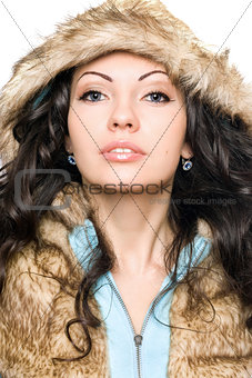 Portrait of perfect young brunette in the hood