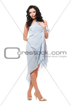 Beautiful young brunette wrapped in blue cloth
