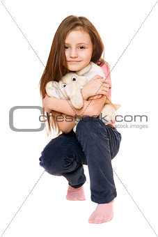 Beautiful little girl with a teddy elephant