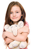 Portrait of smiling little girl with a teddy elephant