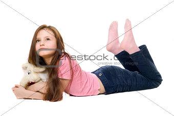 Little girl with a teddy elephant