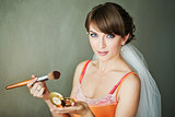 bride doing make-up in the morning.