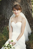 Beautiful bride posing in garden.