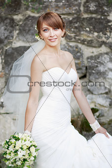 Beautiful bride posing in garden.