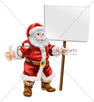 Santa holding sign and doing thumbs up