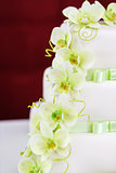 Wedding cake detail with orchid flowers
