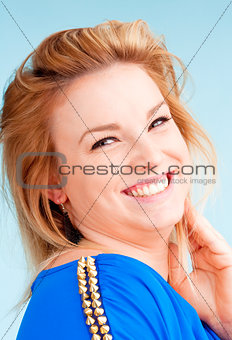 Portrait of Young Woman with Blond Hair Smiling
