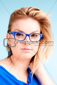 Portrait of Young Woman with Blond Hair and glasses