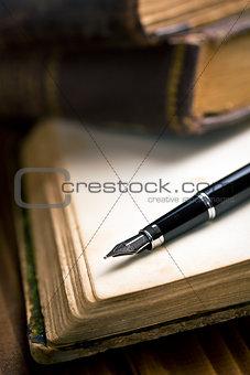 open book with fountain pen