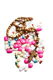 colorful pills with rosary beads