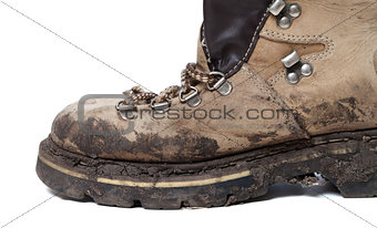 Old trekking boot in mud
