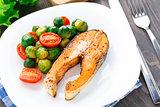 Salmon with roasted brussels sprout and tomato