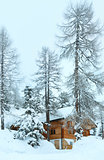 wood house in winter misty mountain