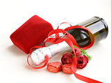 Festive bottle of champagne with chocolate and gifts