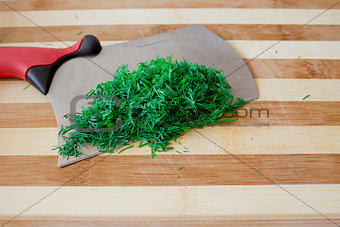 Knife and chopped dill