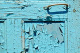 part of cracked old painted blue door