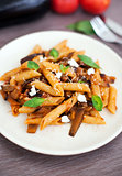 Pasta with tomato sauce, eggplant and ricotta cheese