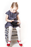 Cute Little Girl Playing with a Tablet Pc