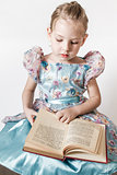 Cute Little Girl Reading an Old Red Book