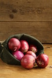 organic red onion on a wooden table