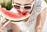 girl in white summer dress eat watermelon