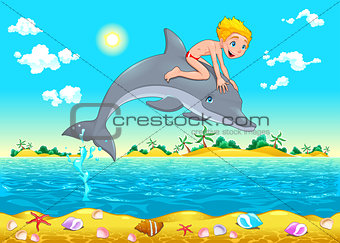 The boy and the dolphin in the sea.
