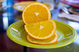 Sliced Orange Fruit on Green Plate