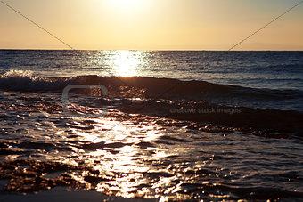 waves on the sea at sunrise