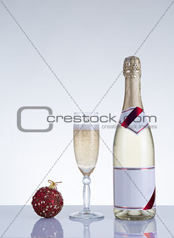 Champagne glass, bottle, and New Year decoration