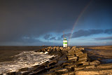rainbow over lighthouse and North sea