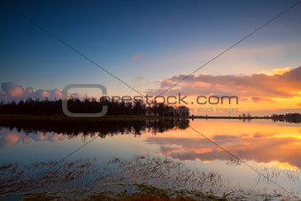 calm sunset over lake surface