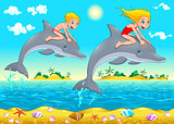 Boy, girl and dolphin in the sea.