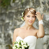 Portrait of happy cheerful smiling bride outdoors