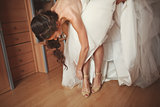 Beautiful young  bride is getting ready