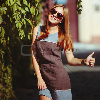 beautiful teenage girl in sunglasses.
