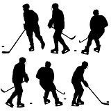 Set of silhouettes of hockey player. Isolated on white. Vector