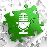 Microphone Icon on Green Puzzle.
