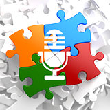 Microphone Icon on Multicolor Puzzle.