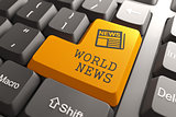 World News Concept on Orange Keyboard Button.