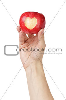 adult man hand holding apple with carved heart