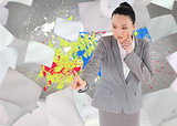 Composite image of unsmiling thinking asian businesswoman pointing