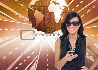 Composite image of happy brunette holding smartphone