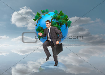 Composite image of cheerful businessman in a hury