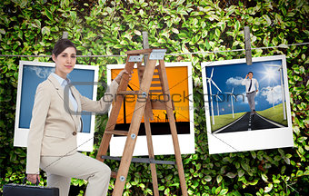 Composite image of businesswoman climbing career ladder with briefcase and looking at camera